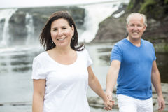 Portrait of loving mature couple relaxing outside Stock Photos