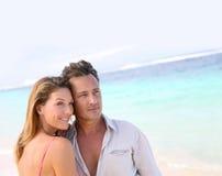 Portrait of loving middle-aged couple enjoying on the beach Royalty Free Stock Photo