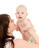 Portrait of loving mother and her child. On white background Royalty Free Stock Photo