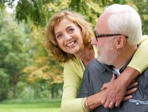 Portrait of a loving older couple smiling outdoors Royalty Free Stock Image