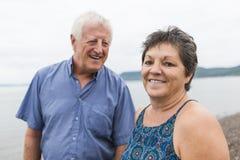 Portrait of loving senior couple at the beach Stock Image