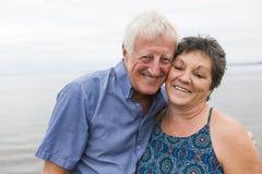 Portrait of loving senior couple at the beach Royalty Free Stock Photo