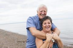 Portrait of loving senior couple at the beach Stock Photo