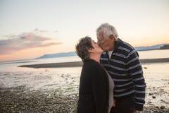 Portrait of loving senior couple at the beach Stock Photos