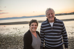 Portrait of loving senior couple at the beach Stock Photography