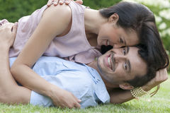 Portrait of loving young couple enjoying together in park Stock Photos