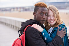 Portrait Of Loving Young International Couple on Sky Background. African Guy and Caucasian Woman Royalty Free Stock Photos