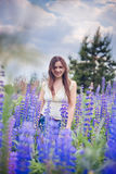 Portrait in lupines Stock Photos
