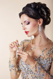 Portrait of Luxurious Caucasian Woman  with Perfume Bottle. Royalty Free Stock Image