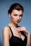 Portrait of luxury woman in exclusive jewelry stock photography