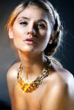 Portrait of luxury woman in exclusive jewelry Royalty Free Stock Image