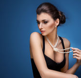 Portrait of luxury woman in exclusive jewelry Stock Image