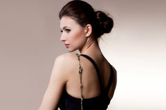 Portrait of luxury woman in exclusive jewelry on natural backgro Stock Images