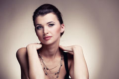 Portrait of woman in exclusive jewelry on natural background Royalty Free Stock Photo
