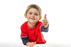 Portrait of lying boy with thumb up Royalty Free Stock Images