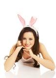 Portrait of lying woman wearing bunny ears Stock Photos