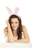 Portrait of lying woman wearing bunny ears Royalty Free Stock Image