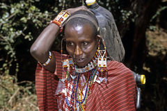 Portrait of Maasai woman carrying water at home Stock Photography