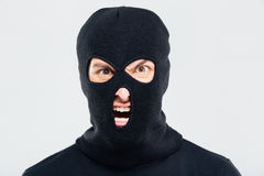 Portrait of mad furious man in balaclava. Isolated Royalty Free Stock Photography