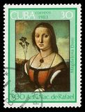 Portrait of Maddalena Doni by Rafael. CUBA - CIRCA 1983: A stamp printed in Cuba shows `Portrait of Maddalena Doni`, 1506 painting by artist Rafael, series royalty free stock image