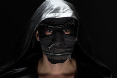 Portrait of the madman in handmade mask Stock Photo
