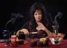 Portrait of magical practitioner burns candles Royalty Free Stock Photos