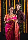 Indian couple with puja / pooja thali. Portrait of Maharashtrian couple holding a puja thali, indian couple holding puja thali or pooja thali, indian couple Royalty Free Stock Images
