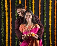Indian couple with puja / pooja thali. Portrait of Maharashtrian couple holding a puja thali, indian couple holding puja thali or pooja thali, indian couple Stock Photo