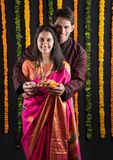 Indian couple with puja / pooja thali. Portrait of Maharashtrian couple holding a puja thali, indian couple holding puja thali or pooja thali, indian couple Royalty Free Stock Photos