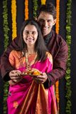 Indian couple with puja / pooja thali. Portrait of Maharashtrian couple holding a puja thali, indian couple holding puja thali or pooja thali, indian couple Royalty Free Stock Photography