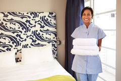 Portrait Of Maid Tidying Hotel Room Stock Images