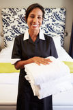 Portrait Of Maid Tidying Hotel Room Stock Photography