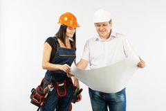 Portrait Of Male Architect And builder Woman Discussing building plan. foreman holding roll paper. On white background stock photography