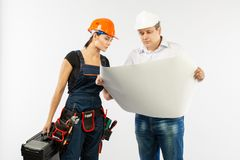Portrait Of Male Architect And builder Woman Discussing building plan. foreman holding roll paper. On white background royalty free stock image
