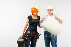 Portrait Of Male Architect And builder Woman Discussing building plan. foreman holding roll paper. On white background stock photos