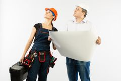 Portrait Of Male Architect And builder Woman Discussing building plan. foreman holding roll paper. On white background stock image
