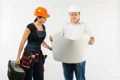 Portrait Of Male Architect And builder Woman Discussing building plan. foreman holding roll paper. On white background royalty free stock photos