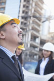 Portrait of male architect with colleagues in background Royalty Free Stock Images