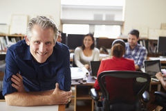 Portrait Of Male Architect With Meeting In Background Stock Image