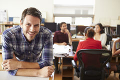Portrait Of Male Architect With Meeting In Background Royalty Free Stock Image