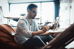 Portrait Of Male Artist Working On Painting In Studio Stock Images