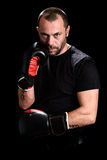 Portrait of male athlete boxer man looking aggressive with boxin Stock Images