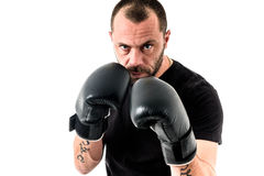 Portrait of male athlete boxer man looking aggressive with boxin Royalty Free Stock Photography