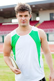 Portrait of a male athlete holding a discus Stock Photography