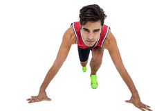 Portrait of male athlete in ready to run position Royalty Free Stock Photos