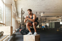 Portrait of male athlete standing on box. In gym. crouches stock photos