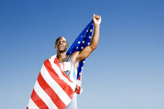 Portrait of a male athlete with US flag stock photo