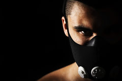 Portrait of male athlete wearing training mask. Portrait of male athlete wearing training mask, closeup Stock Photos