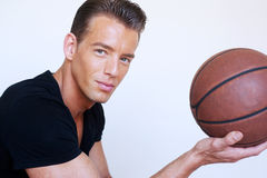 Portrait of a male basketball player holding the b Royalty Free Stock Photography