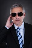 Portrait Of Male Body Guard. Over Black Background royalty free stock photos